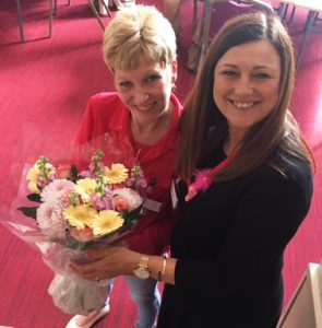Judith Lockett receives flowers from Adrienne Evans, Executive Officer and PA to the Director, Research and Innovation Services